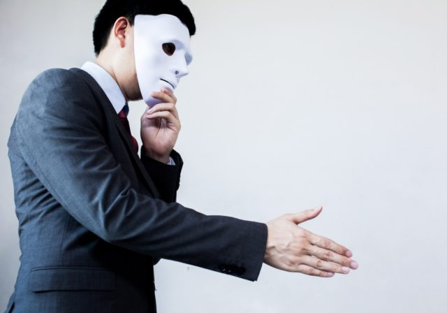 image of man with mask holding out hand to denote dishonest assistance