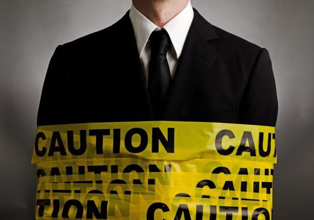 business-man-caution-tape-blog-image