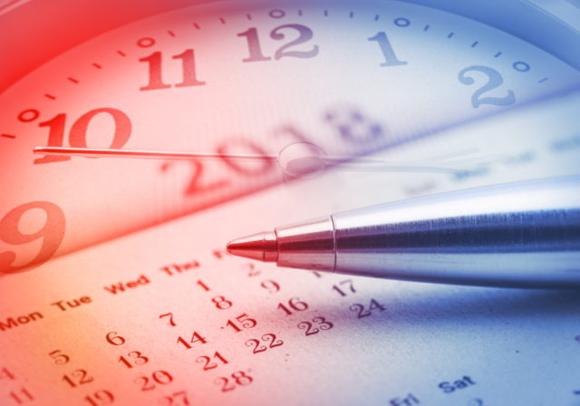 image of pen over calendar and clock